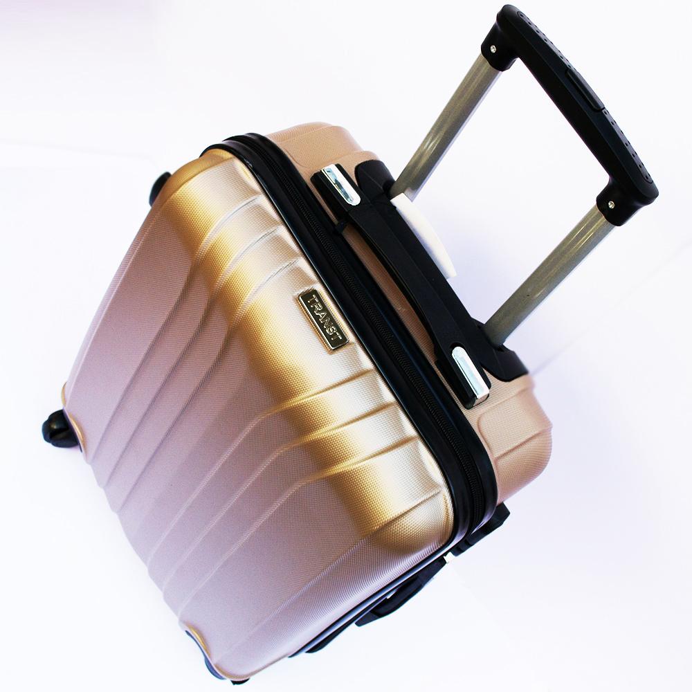 Ново поколение ръчен куфар - спинър със свалящи се колела TRANSIT J01 GOLD, ABS